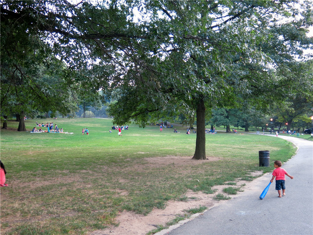 Families picnicking and children playing at Inwood Park