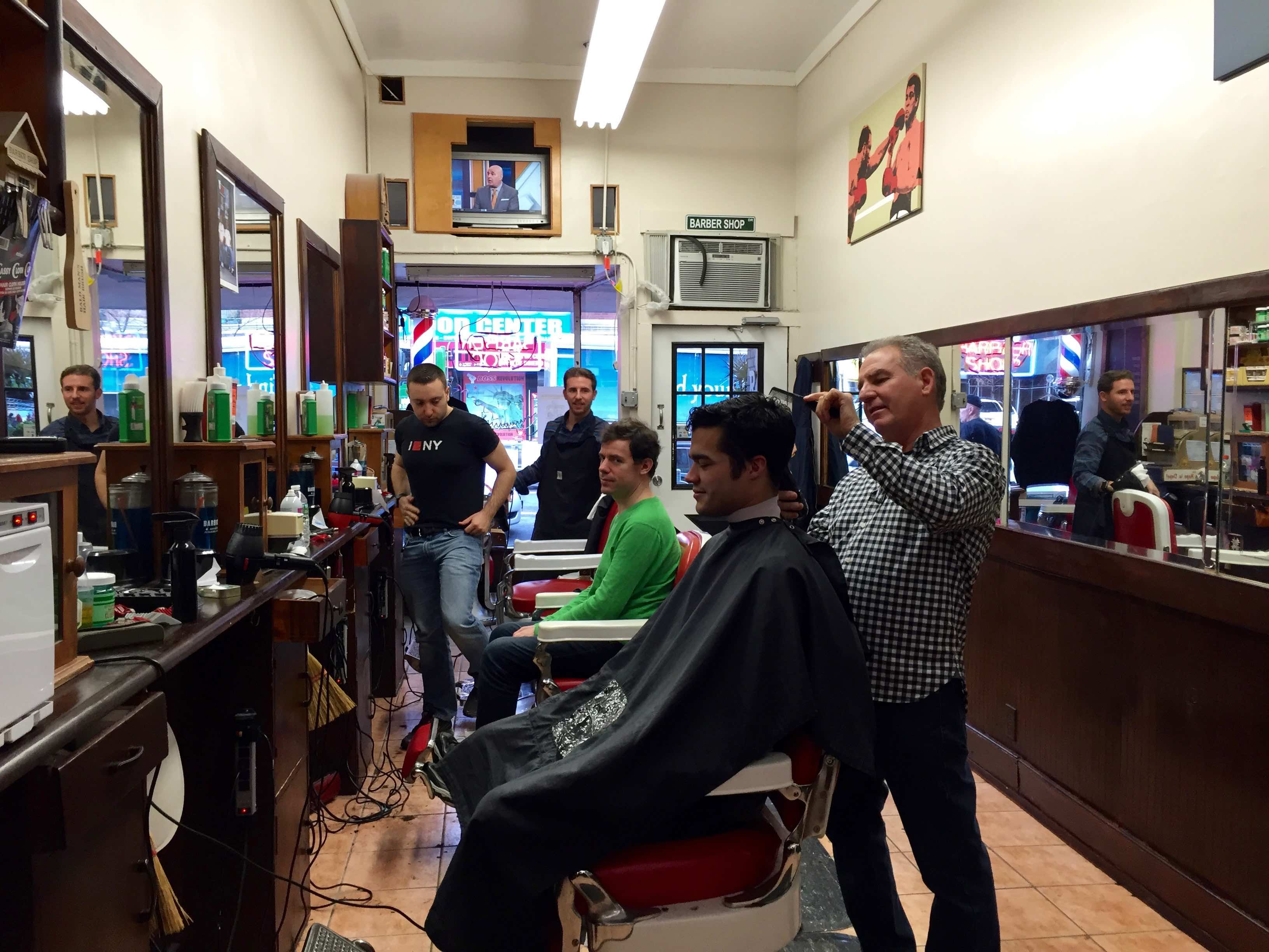Ray Sr. cutting hair at Ray's Barber Shop in Inwood NY